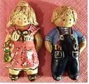 2 Keramik-Figuren für die Wand - Junge und Mädchen - ca. 20 cm Lä